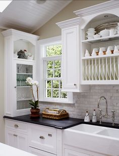 The beauty is in the details of the cabinets in this fresh kitchen redo by Jules Duffy Designs.