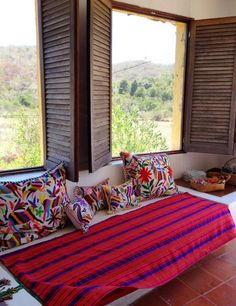 Daybed with Otomi pillows.