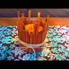 Cinnamon stick candle holder.   Broken cinnamon sticks, hot glue gun, and twine. Bad-a-bing!