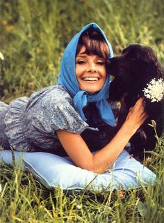 """Audrey Hepburn photographed with Cokey (the Spaniel dog, that belonged to her eldest son Sean Ferrer) by Henry Clarke at the gardens of her famous """"La Paisible"""" in Tolochenaz (Switzerland), in February 1971."""
