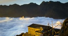 Lodge above the clouds at Thare Pati at sunset along the Helambu trekking circuit, Nepal
