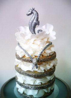 Mini cake with sea inspired topper <3