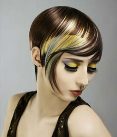 "FTOP: ""Elena Bogdanets of Canada wows with this fabulous color design. We also heart the matchy-matchy hair and eye shades - something that looks extraordinary when a creative color is involved. Photog: Lucy Literna; MUA: Julia Adamenko"". Normally I'm not a fan of grey and yellow together, but this works."