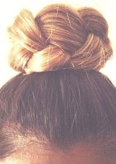 Wrap your braid into a topknot and secure with pins