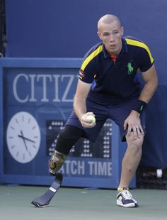 Despite his injury from his service in Afghanistan, The U.S. Army Specialist Ryan McIntosh is not slowing down as he works a ballperson at the U.S. Open. ballperson, soldier, leg, balls, american hero, afghanistan, adapt sport, america hero, tennis