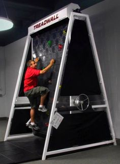 An exercise room with a rock climbing treadmill