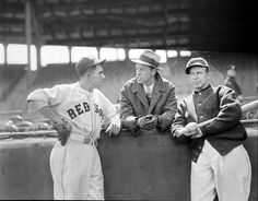 (l to r:) Boston Red Sox Mel Almada, Billy Werber (in civvies) and Boston Red Sox Rick Ferrell standing along the railing at Fenway Park between 1933 and 1936.