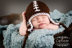 Can't get enough of babies in football beanies.