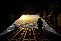U.S. Air Force Airman 1st Class Ryan Suggs, a loadmaster assigned to 52nd Expeditionary Airlift Squadron, monitors cloud cover in preparation for pararescuemen assigned to the 82nd Expeditionary Rescue Squadron to jump from a C-130J Super Hercules aircraft over Djibouti, March 12, 2014. (United States Air Force photo by Staff Sgt. Staci Miller) ~~  MilitaryAvenue.com