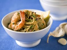 Dawn's Scampi - This shrimp scampi is cooked in chicken broth instead of butter and gets an extra punch of flavor from kalamata olives.