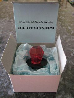 Now that he's popped the question, brides-to-be can pop a question of their own.  Ladies, just use an empty box, some tissue paper, and a ring pop, and you can stage a memorable proposal to ask that special someone if they'll be your bridesmaid.