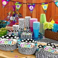 A graduation party buffet table with eye-popping color is as easy as 1-2-3! Combine polka-dot and neon tableware with bright party cups and cutlery for an awesome set-up!