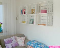 Sand, primer, and paint wooden milk crates, and hang!