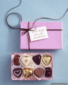 "Chocolate favors with a note that reads ""Sweet hearts from the sweethearts"""