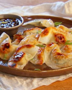 "(Must check out the sauce recipe) Dumpling wrappers -- Chinese wonton or Japanese gyoza skins are the same thing -- are now widely available in the frozen-food section of most markets. From the book ""Mad Hungry"" by Lucinda Scala Quinn (Artisan Books)."