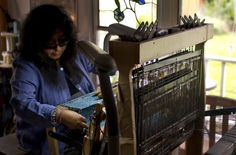Consuelo Jimenez Underwood, of Cupertino, works on a textile design from inside her home studio