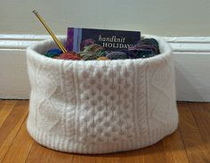 """Felted Sweater Knitting Basket by kathrynivy.com, via Flickr."" She made this following a Martha Stewart tutorial, but I have to say it's an awful tutorial -- pictures only halfway through the process! Still, if this woman could make such a beautiful bowl from poor instructions, I probably can, too! :) I just have to watch out for a good sweater to do this with."