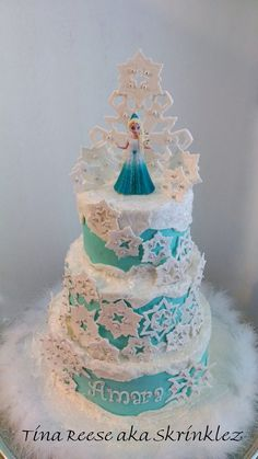 Disney's Frozen - Cake iced in buttercream, snowflakes and topper made with gumpaste/fondant mix.  *