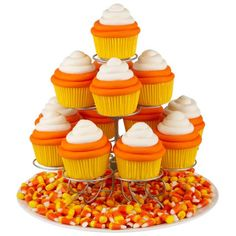 Delight Halloween party guests with cupcakes ringed in orange and white buttercream icing, and displayed on Wilton's Cupcakes 'N More® Dessert Stand. They're easy to create using a decorating tip 2A. cupcake displays, candi corn, halloween parties, candy corn, candies, halloween cupcakes, candycorn, corn cupcak, oranges