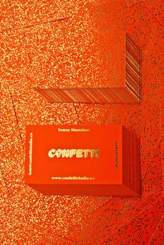 Red card and gold foil business cards for Confetti Studio.