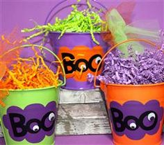 Metal buckets with halloween image on the front.