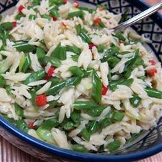 """Green Bean Orzo Pasta   """"This is an easy, nutritious, warm, and slightly nutty pasta dish that pairs well with just about any meat. This recipe is very adaptable. Want garlic or onion? Add it! More pine nuts? Great! Flavored tomatoes? Do it. It will pretty much work with whatever you have or want."""""""