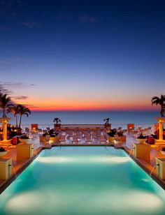Wedding ceremonies on this pool terrace in Florida allow for Gulf and sunset views without sand sticking to clothes and feet!