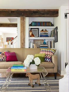 Layer pieces of art with books and other accessories. More tips for arranging bookshelves: http://www.bhg.com/decorating/storage/shelves/get-picture-perfect-bookshelves/?socsrc=bhgpin082613art=11