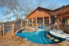 This amazing pool and backyard playground provides plenty of space for relaxing and entertaining, yet stays in tune with the rugged woodsy surroundings. Elite Pools by Scott, Little Rock, Arkansas http://www.luxurypools.com/builders-designers/elite-pools-by-scott.aspx