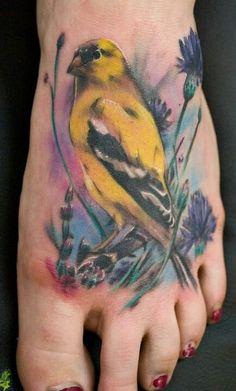 Beautiful bird tattoo. Love the colours.