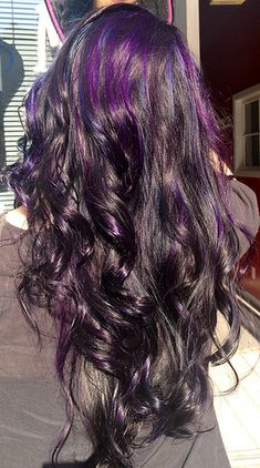 Purple and blue highlights on black hair.