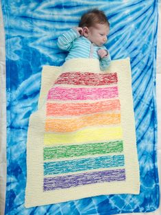 A beautiful rainbow striped blanket for the stroller or crib made with Bonbons and Vanna's Choice Baby.
