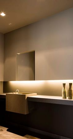 | BATHROOMS | Image Credit: interieurarchitect Frederic Kielemoes    Lovely use of drywall detailing to frame a hung mirror and provide recessed lighting, ambient lighting proves to be a much more interesting way to illuminate surfaces. Lovely powder room detail #bathrooms #lighting #details