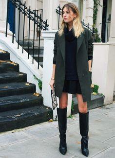 green winter coat, tall boots