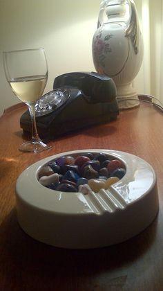 Art Deco ashtray repurposed to display polished semi-precious stones.  Love it!