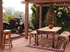 southwest style outdoor room with antique tractor