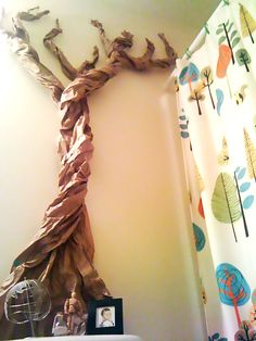 """My friend Recycled this paper to make a cool tree in the kid's bathroom. Her son says it reminds him of """"Where the Wild Things Are"""" #recycled #kids crafts #tree"""