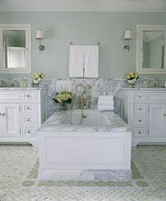 White marble soaking tub and double vanity Phoebe Howard