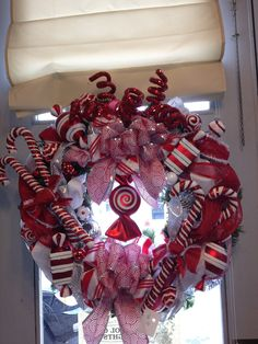 """Beautiful Candy themed Christmas Wreath. App. 18 to 20"""" standard size.. $150.00, via Etsy."""
