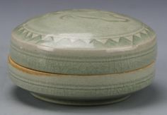 China (ca.18/19th C), Lungquan-ware makeup box with an incised bird on cover, geometric forms bordering central scene (h: 1.5 x w: 3.5 in).