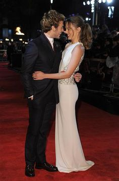 "Sam Claflin(Finnick) & his wife on the red carpet @ the ""Catching Fire"" London premiere. :)"