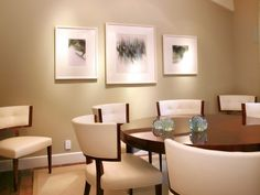 Elegant-dining-room-with-round-table-cream-chairs-and-beige-carpet-with-wood-floor