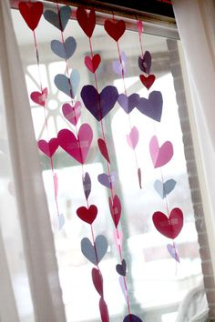 Make a heart garland for a Valentine's Day window! Scissors and fine motor practice for preschoolers to cut out hearts and tape up together hearts! Great way to keep track of your acts of kindness for the #100actsofkindness project