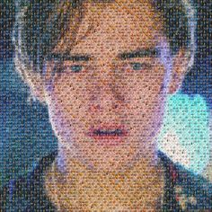 That's a picture of Leonardo DiCaprio crying, made out of tiny pictures of Oscar winners... Cruel.