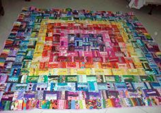 "Around the world, rainbow style! This is a strip quilt put together in an ""around the world"" format. The quilt is made of 6-inch squares that were put together using the quilt-as-you-go method, creating an 84x84 inch quilt."