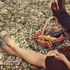 A beautiful picnic engagement session surrounded by cherry blossoms by Heather Espana