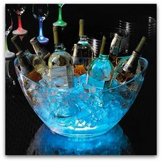 Place glow sticks at the bottom of a large glass or plastic bowl, fill with ice, and use it to chill and light up your drinks. Some other AWESOME glow stick ideas, too!