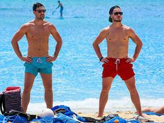 Dancing with the Stars sibs Maksim (left) and Val Chmerkovskiy make the Hawaiian surf look even more inviting on Wednesday while kicking back beachside in Waikiki, Hawaii.