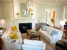 Neutral Beachy Living Room with large light fixture, white couches, beadboard and mirror over fireplace - Elizabeth Newman Interior Design (Charleston Portfolio)