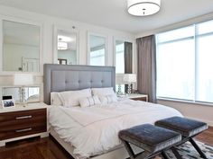In a room with large windows, reflect the light with large mirrors. http://www.hgtv.com/bedrooms/designer-tricks-for-living-large-in-a-small-bedrooom/pictures/page-13.html?soc=pinterest